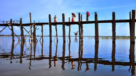 Walk the world's longest teak bridge in Vietnam - Savile Row Travel